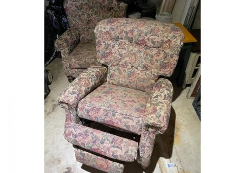 Two reclining living room chairs